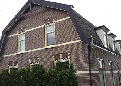Zijgevel restauratie woning Oranjeweeshuisstraat te Huizen